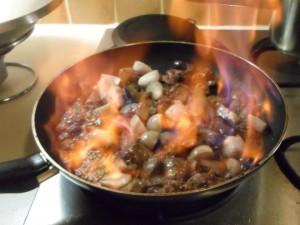 terrinne van spitskool met kippenlevertjes- het flamberen