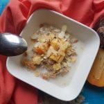 Pap van quinoa, kaki en amandelen; een warm winter ontbijt
